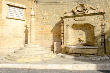 Old fountain in center of Victoria on Gozo island