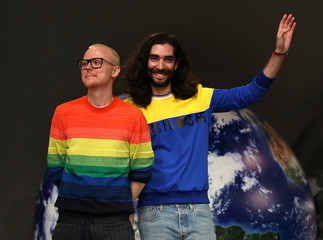 Fashion designers Fyodor Podgorny and Golan Frydman acknowledge the audience after their show at London Fashion Week, in London