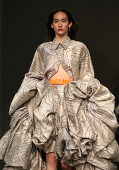 A model presents a creation during the Fyodor Golan show at London Fashion Week, in London
