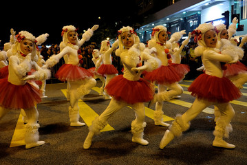 Young dancers dressed as puppies take part in a parade to celebrate the Year of the Dog in Hong Kong
