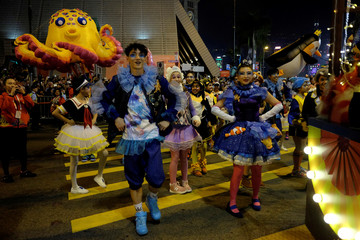 Dancers take part in a parade to celebrate the Year of the Dog in Hong Kong