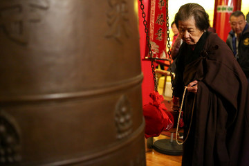 Senior parishioner Ci Heng rings a bell 108 times to welcome the Chinese Lunar New Year in Manhattan's Chinatown in New York