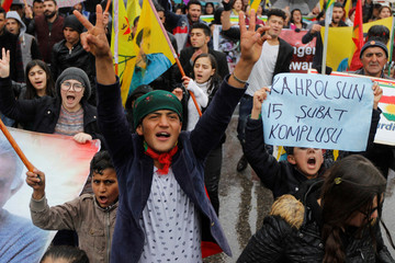 Kurdish demonstrators shout slogans during a protest demanding the release of the Kurdistan Workers Party (PKK) leader Abdullah Ocalan, in Sulaimaniyah