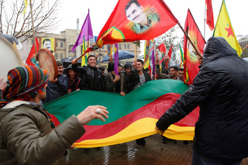 Kurdish demonstrators hold flags during a protest demanding the release of the Kurdistan Workers Party (PKK) leader Abdullah Ocalan, in Sulaimaniyah
