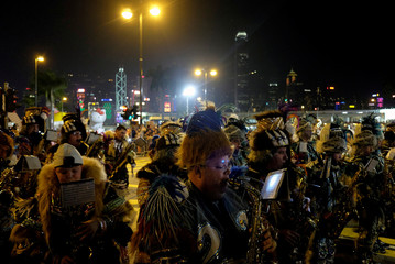 Quaker City String Band from Philadelphia performs during a parade to celebrate the Year of the Dog in Hong Kong