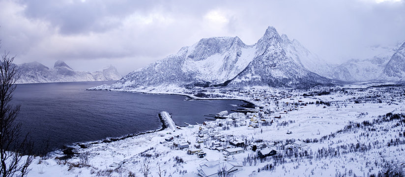Panoramic View over Town Surrounded by Snowy Mountains