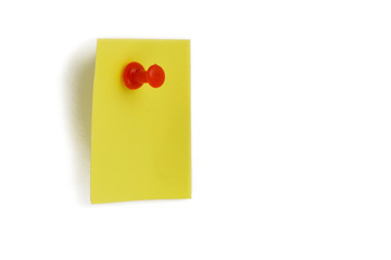 Yellow paper with a pin stock images. Tack on a white background. Red plastic tacks. Yellow office paper