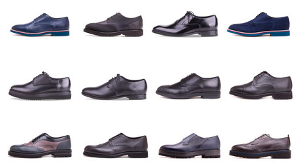 Group of male shoes on white background