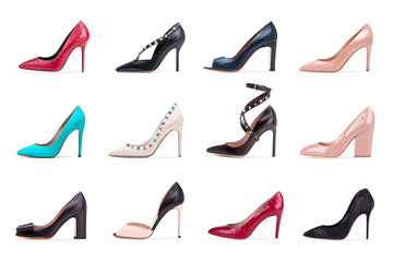 Collection of women's high-heeled shoes. A collection of women's high-heeled shoes. A group of diverse female shoes on a white background.