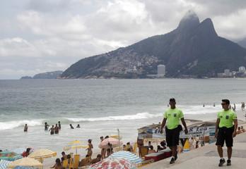 Policemen patrol Arpoador beach in Rio de Janeiro