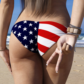Rear backside view of a fit brunette female wearing an American flag style bathing suit at a sunny beach. Woman is posing with two fingers symbolizing peace or peace sign. 3d rendering