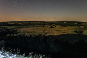 View of green forest-steppe plain at night. River Koren (Root) valley, typical landscape of Belgorod region, Russia.