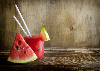 Fresh water melon smoothie on a wooden background, rural style, selective focus