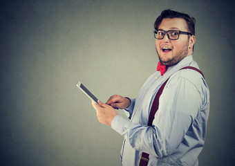 Excited man impressed with new tablet
