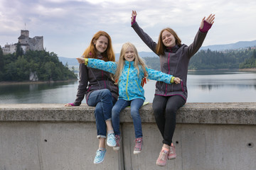 Happy family - mom and two daughters