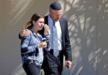 Mourners leave the funeral for Alyssa Aldaheff, 14, one of the victims of the school shooting, in North Fort Lauderdale