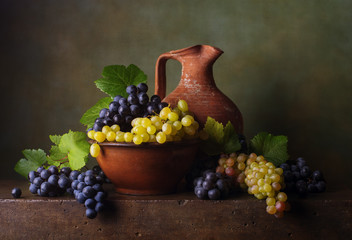 Still life with grapes in the bowl and jug