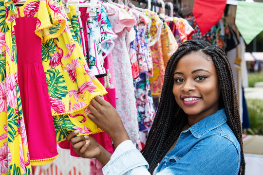 African american woman with colorful clothes at market