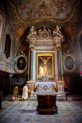 The Baroque interior and frescoes of the Abbey of Monte Oliveto Maggiore is a large Benedictine monastery in the Italian region of Tuscany, near Siena.