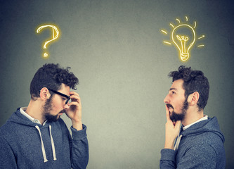 Two men thinking one has a question another solution with light bulb above head
