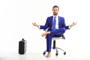Businessman gets rid of stress and relaxing after working day.