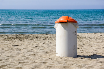 Trash can on the beach sunny day. Concept photo of a clean beach