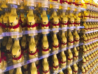 Berlin, Germany many a lot of Lindt Gold Bunny army. Easter Rabbit Dressed in gold, with a ribbon and golden bell that rings, it is the iconic Lindt Easter chocolate