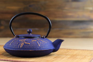 Blue Chinese cast iron teapot. Cooking utensils.