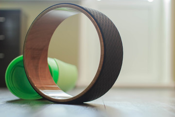 A ring for practicing yoga and a green yoga mat. Yoga in the office.