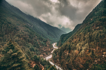 Wall Mural - The spectacular landscape the dense coniferous forests and the mountain river in the canyon of the Himalayas. Everest Base Camp trek in the Sagarmatha National Park in the north-eastern Nepal.