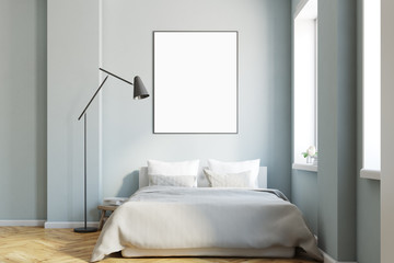 Gray bedroom interior with a poster