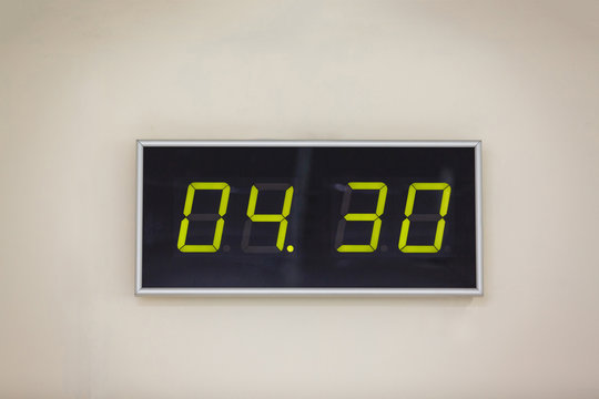 Black digital clock on a white background showing time 4 hours 30 minutes