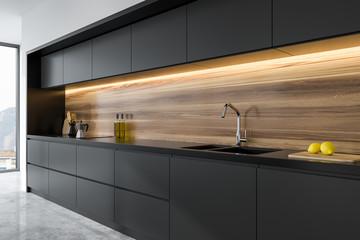 Panoramic black and wooden kitchen corner