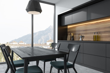 Dark gray dining table in a gray kitchen corner