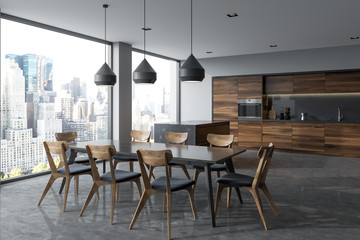 Dark gray dining table in a panoramic kitchen
