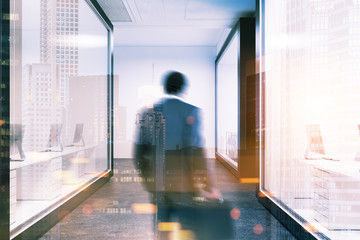 Businessman in a white wall office lobby