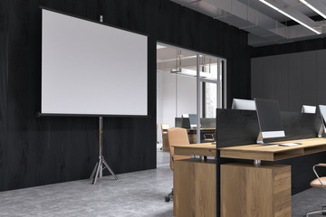 Black office interior, screen for presentations