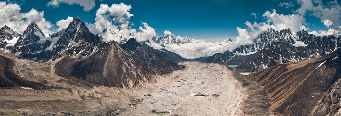 Wall Mural - Breathtaking panoramic view in the Gokyo Lakes region. The mighty snow-covered mountain range on the way to the Everest Base Camp in the Nepal. Strength and beauty of the untouched nature.