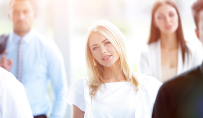 closeup of confident business woman on blurred background office