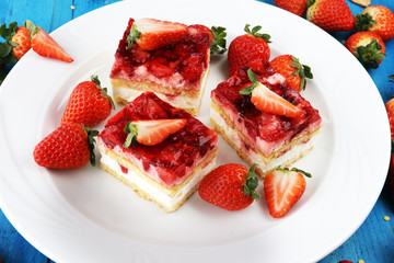 strawberry cake with fresh strawberries and whipped cream.