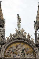 statue decorate the rooftop of the Basilica di San Marco (Saint Mark`s Basilica) in Venice, Italy. ..