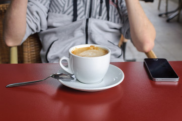 cup of coffee on a table in a cafe close-up