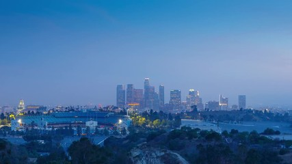 Fototapete - Zoom in on downtown of city of Los Angeles skyline at night.  4K UHD Timelapse.