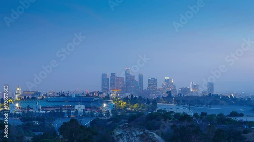 Fotobehang Zoom in on downtown of city of Los Angeles skyline at night.  4K UHD Timelapse.