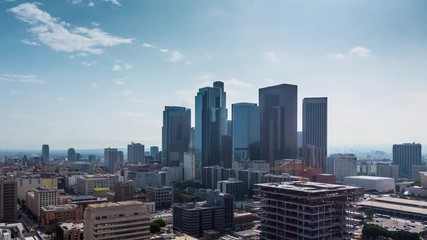 Fototapete - Zoom in on downtown Los Angeles. Aerial view of day city. 4K UHD timalapse