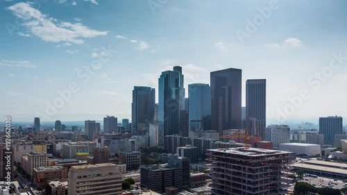 Fototapete Zoom in on downtown Los Angeles. Aerial view of day city. 4K UHD timalapse