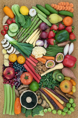 Healthy super food collection with fresh vegetables, fruit and nuts. Health food concept high in omega 3 fatty acids, antioxidants, anthocyanins, minerals, vitamins and  fibre.