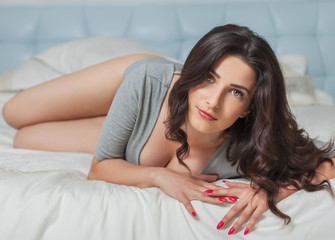 Pretty woman on a bed
