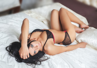Sexy woman on a bed