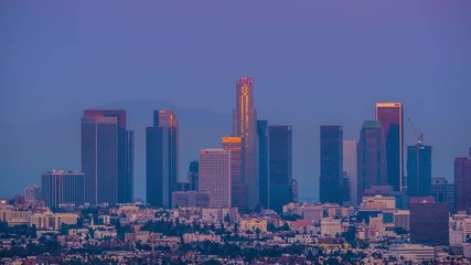 Fototapete - Downtown Los Angeles skyline changing from sunset to night city 4K UHD Timelapse